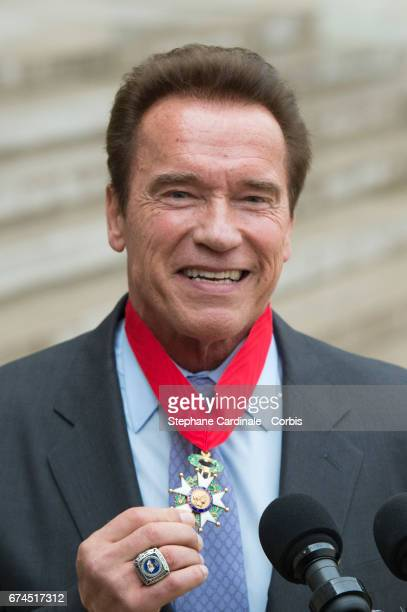 US actor and former governor of California Arnold Schwarzenegger poses after he was awarded France's highest national order the 'Chevalier de la...