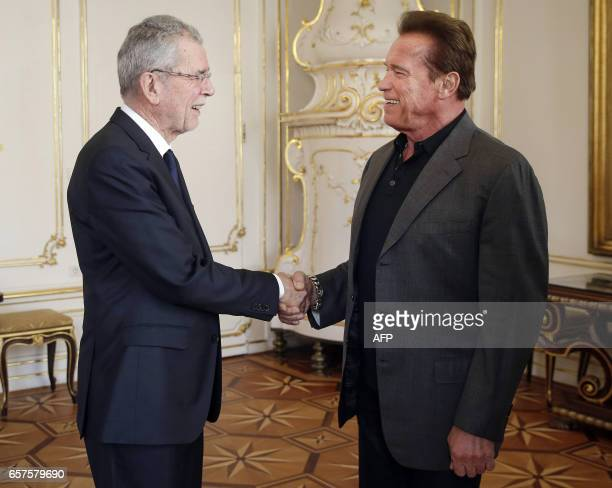US actor and former governor of California Arnold Schwarzenegger shakes hands with Austrian President Alexander Van der Bellen on March 25 2017 at...