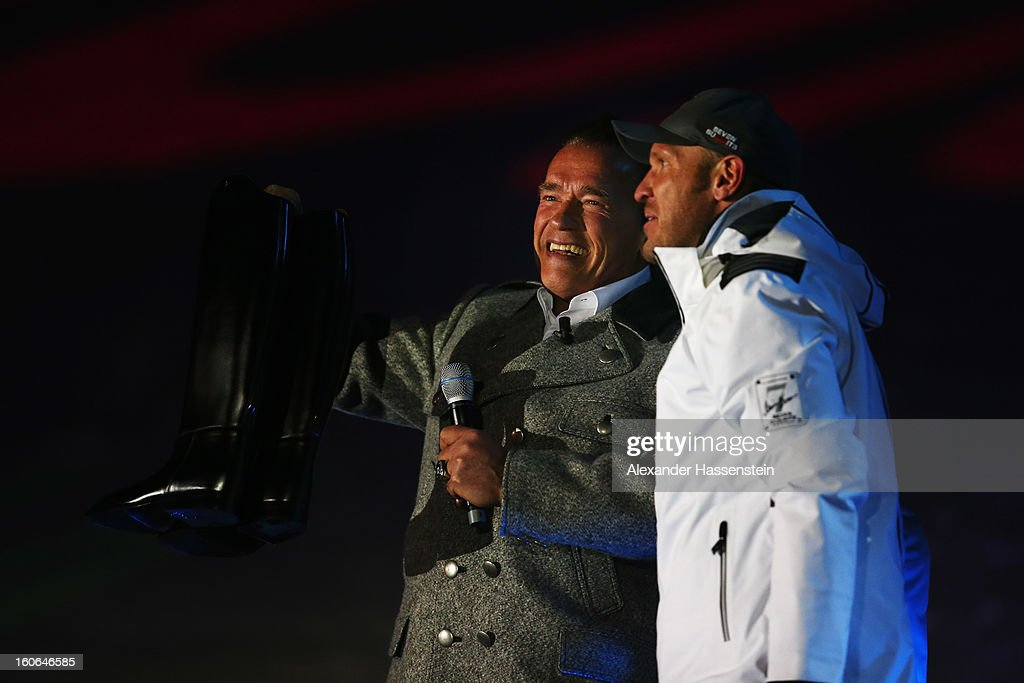 Actor and former Governor of California Arnold Schwarzenegger talks with former Austrian skier Hermann Maier during the opening ceremony for the...