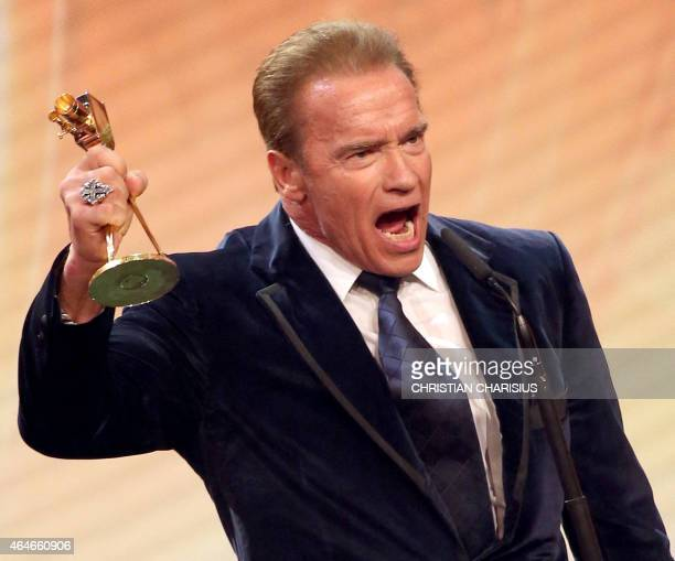 US actor and former governor of California Arnold Schwarzenegger celebrates with the lifetime achievement award at the annual German film and...