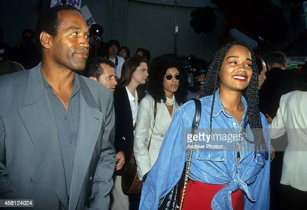 Actor and former NFL player OJ Simpson and daughter Arnelle arrive for the 'Cliffhanger' premiere on May 26 1993 at the Mann's Chinese Theatre in...