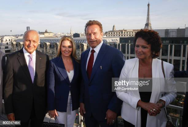 US actor and founder of the R20 climate action group Arnold Schwarzenegger and his girlfriend Heather Milligan pose with President of the French...
