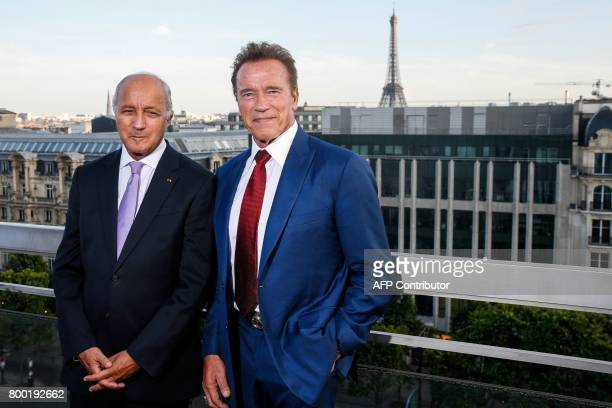 US actor and founder of the R20 climate action group Arnold Schwarzenegger poses with President of the French Constitutional council Laurent Fabius...