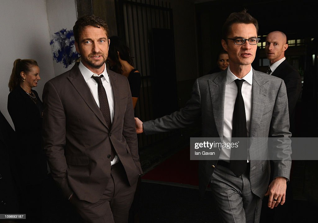 Actor and friend of the Roger Dubuis brand <a gi-track='captionPersonalityLinkClicked' href=/galleries/search?phrase=Gerard+Butler+-+Actor&family=editorial&specificpeople=202258 ng-click='$event.stopPropagation()'>Gerard Butler</a> (L) and Roland Ott, director of communications arrives for the Excalibur Dinner hosted by Roger Dubuis during the 23rd Salon International de la Haute Horlogerie at Caves des Vollandes on January 21, 2013 in Geneva, Switzerland.