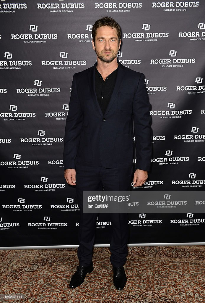 Actor and friend of the Roger Dubuis brand <a gi-track='captionPersonalityLinkClicked' href=/galleries/search?phrase=Gerard+Butler&family=editorial&specificpeople=202258 ng-click='$event.stopPropagation()'>Gerard Butler</a> visits the booth during the 23rd Salon International de la Haute Horlogerie at the Geneva Palexpo on January 21, 2013 in Geneva, Switzerland.