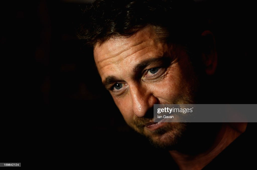 Actor and friend of the Roger Dubuis brand <a gi-track='captionPersonalityLinkClicked' href=/galleries/search?phrase=Gerard+Butler+-+Actor&family=editorial&specificpeople=202258 ng-click='$event.stopPropagation()'>Gerard Butler</a> visits the booth during the 23rd Salon International de la Haute Horlogerie at the Geneva Palexpo on January 21, 2013 in Geneva, Switzerland.