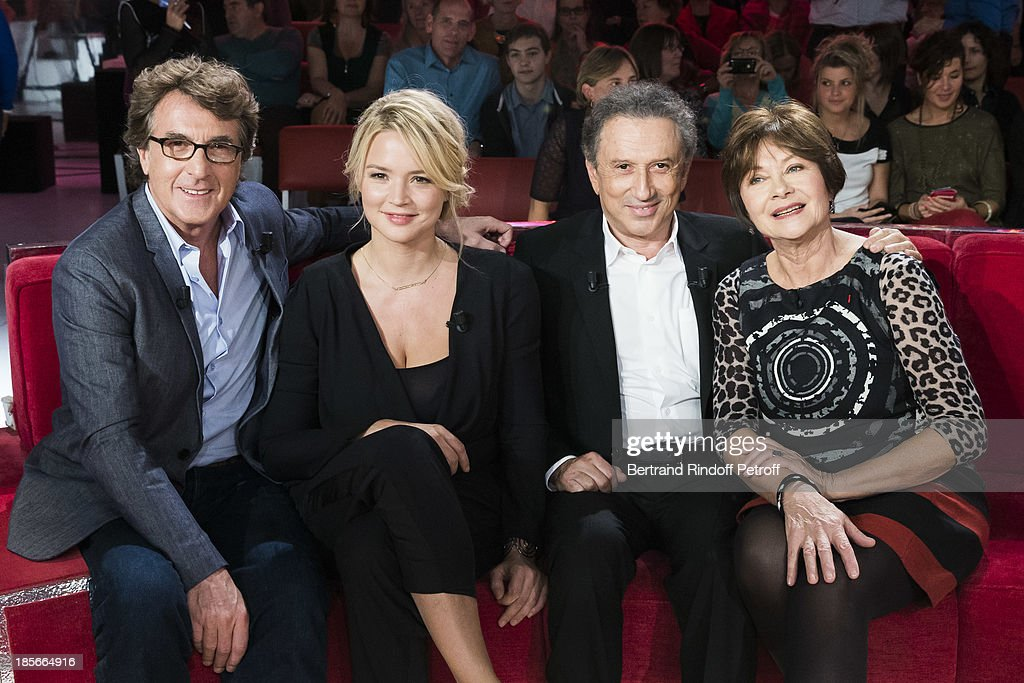Actor and guest of honor <a gi-track='captionPersonalityLinkClicked' href=/galleries/search?phrase=Francois+Cluzet&family=editorial&specificpeople=626602 ng-click='$event.stopPropagation()'>Francois Cluzet</a>, actress <a gi-track='captionPersonalityLinkClicked' href=/galleries/search?phrase=Virginie+Efira&family=editorial&specificpeople=228714 ng-click='$event.stopPropagation()'>Virginie Efira</a>, show host <a gi-track='captionPersonalityLinkClicked' href=/galleries/search?phrase=Michel+Drucker&family=editorial&specificpeople=769504 ng-click='$event.stopPropagation()'>Michel Drucker</a> and actress <a gi-track='captionPersonalityLinkClicked' href=/galleries/search?phrase=Macha+Meril&family=editorial&specificpeople=672802 ng-click='$event.stopPropagation()'>Macha Meril</a> pose during an interruption of the recording of 'Vivement Dimanche' television show at Pavillon Gabriel on October 23, 2013 in Paris, France. Cluzet and Efira are promoting their latest film 'En Solitaire' (Alone).