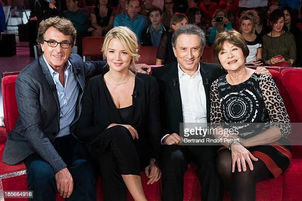 Actor and guest of honor Francois Cluzet actress Virginie Efira show host Michel Drucker and actress Macha Meril pose during an interruption of the...