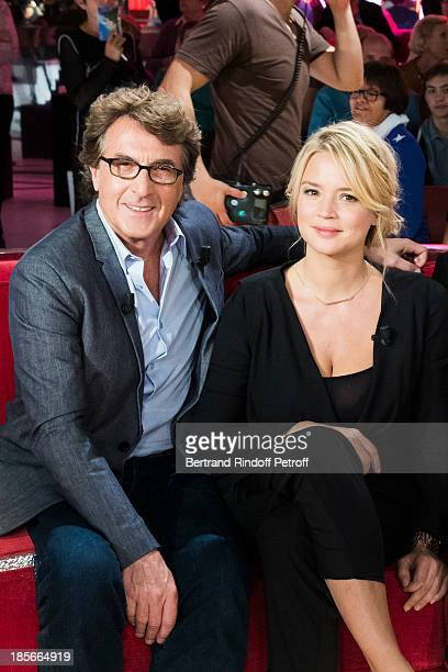 Actor and guest of honor Francois Cluzet and actress Virginie Efira pose during an interruption of the recording of 'Vivement Dimanche' television...