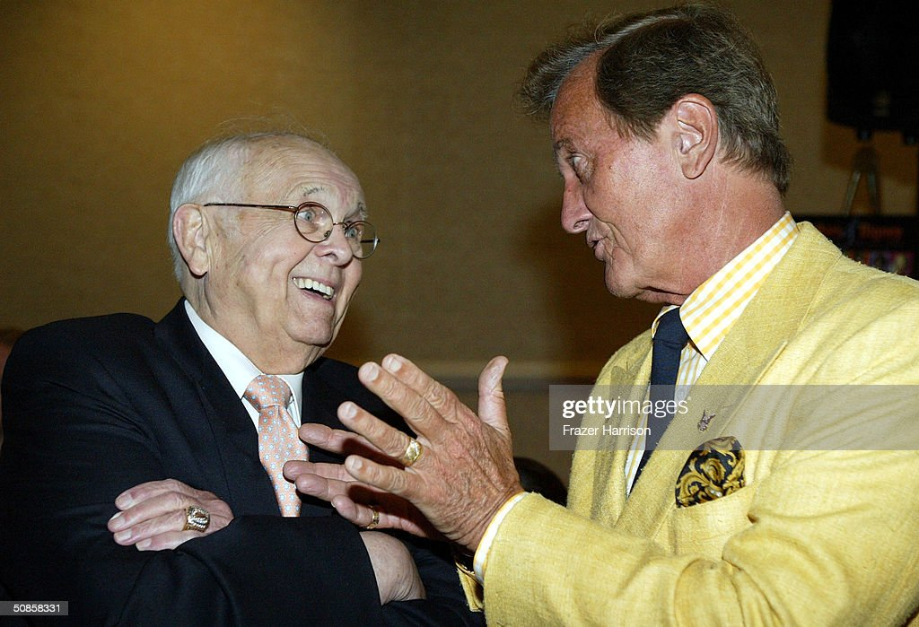 Actor and Honorary Mayor of Hollywood Johnny Grant (L) talks to Pat Boone at the VIP luncheon to celebrate the 50th Anniversary of Solters & Digney Public Relations, and its founder Lee Solters, held on May 19, 2004 at the Beverly Hilton Hotel in Beverly Hills, California.