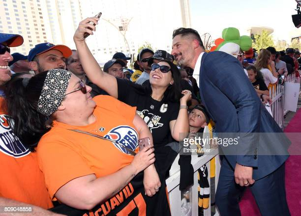 Actor and host Joe Manganiello poses for a photo with a fan as he attends the 2017 NHL Awards at TMobile Arena on June 21 2017 in Las Vegas Nevada