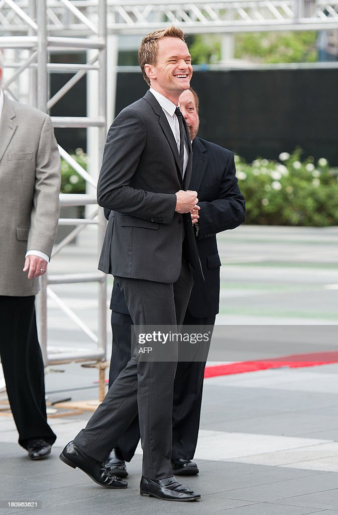Actor and host of the Emmy Telecast Neil Patrick Harris attends the Red Carpet Rollout during the 65th EMMY Awards Press Preview Day on September 18, 2013 in Los Angeles, California.