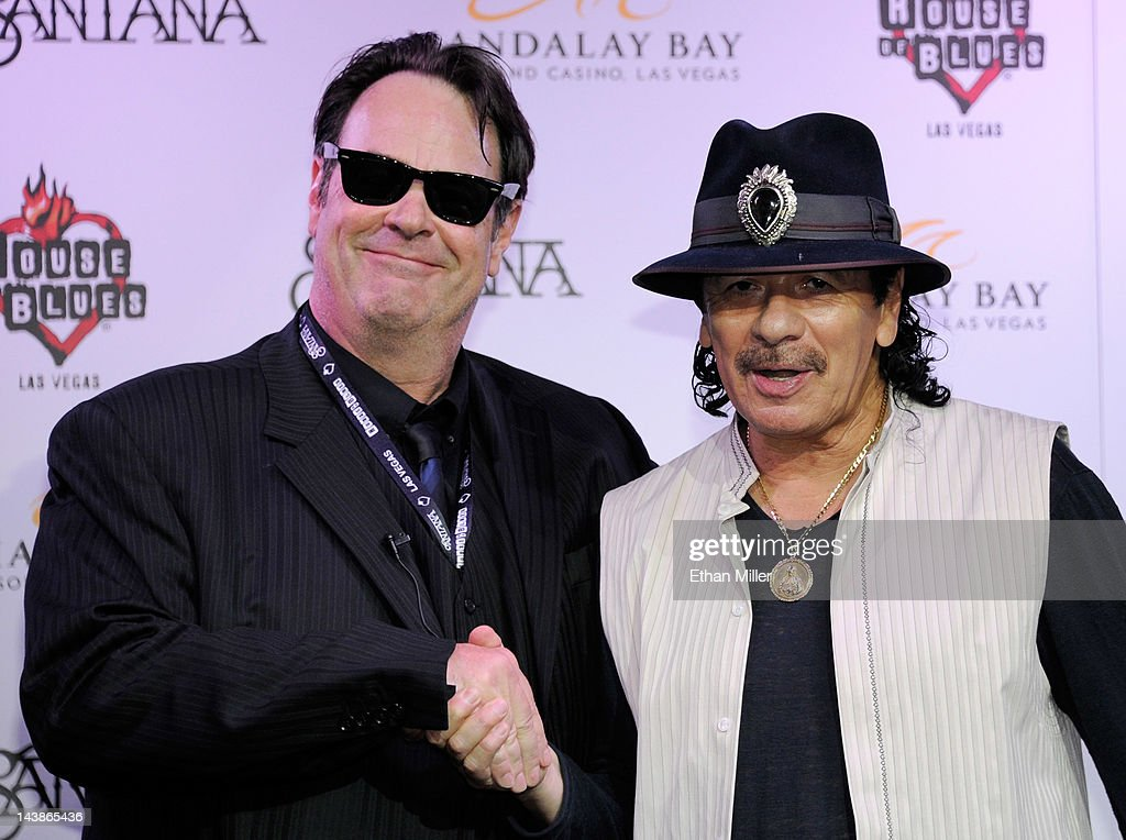 Actor and House of Blues co-founder <a gi-track='captionPersonalityLinkClicked' href=/galleries/search?phrase=Dan+Aykroyd&family=editorial&specificpeople=206819 ng-click='$event.stopPropagation()'>Dan Aykroyd</a> (L) and recording artist Carlos Santana appear at the House of Blues inside the Mandalay Bay Resort & Casino during a mud ceremony May 4, 2012 in Las Vegas, Nevada. The ceremony involved combining dirt from the town of Clarksdale in the Mississippi Delta with dirt from Bethel, New York from the site of the Woodstock Festival and mud from Santana's hometown of Autlan de Navarro, Jalisco in Mexico to symbolize his two-year residency at the music venue.
