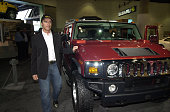 Actor and Hummer patron Arnold Schwarzenegger pauses to check out the 2003 Hummer H2 at the Los Angeles Auto Show Friday Jan 4 2002 at the Los...