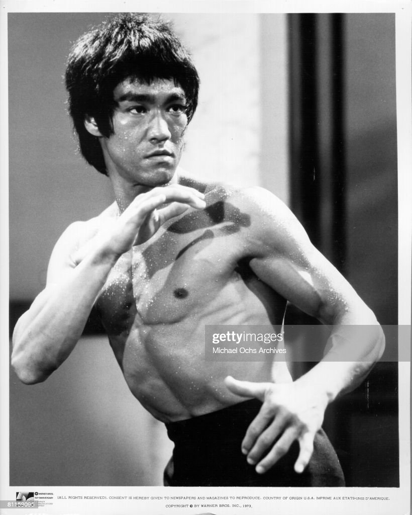 Actor and martial artist <a gi-track='captionPersonalityLinkClicked' href=/galleries/search?phrase=Bruce+Lee+-+Actor&family=editorial&specificpeople=453429 ng-click='$event.stopPropagation()'>Bruce Lee</a> poses for a Warner Bros publicity still for the film 'Enter the Dragon' in 1973 in Hong Kong.