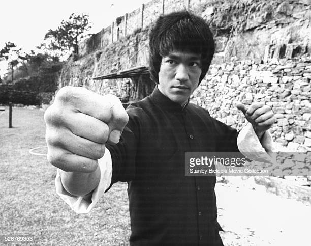 Actor and martial artist Bruce Lee rehearsing on the set of the film 'Enter the Dragon' Hong Kong circa 1973