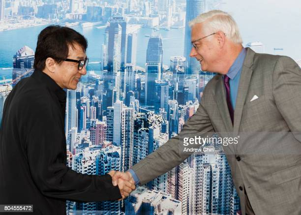 Actor and martial artist Jackie Chan greets President and CEO of Vancouver Airport Authority Craig Richmond during the celebration of Hong Kong...