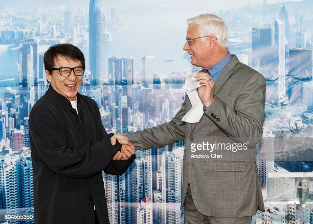 Actor and martial artist Jackie Chan handshakes President and CEO of Vancouver Airport Authority Craig Richmond during the celebration of Hong Kong...