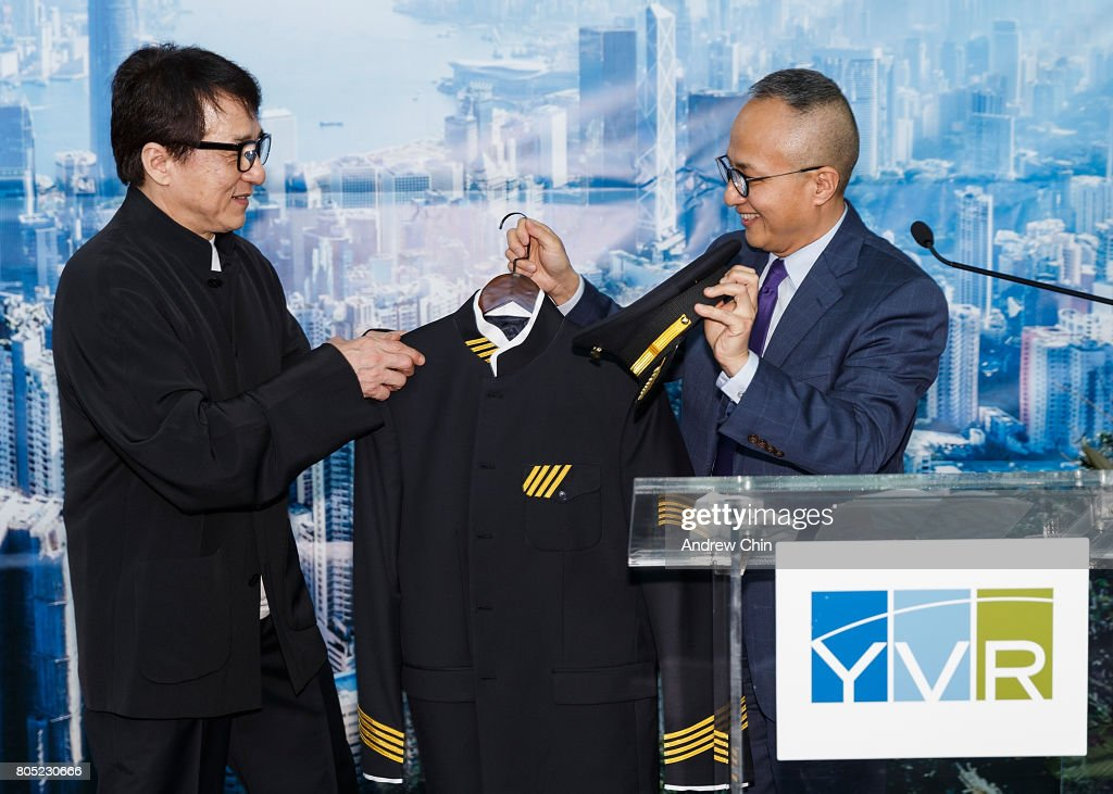 Actor and martial artist Jackie Chan receives a pilot's suit from Chief Marketing Officer of Hong Kong Airlines George Liu during the celebration of Hong Kong Airlines' inaugural flight to Vancouver, BC at Vancouver International Airport on June 30, 2017 in Vancouver, Canada.