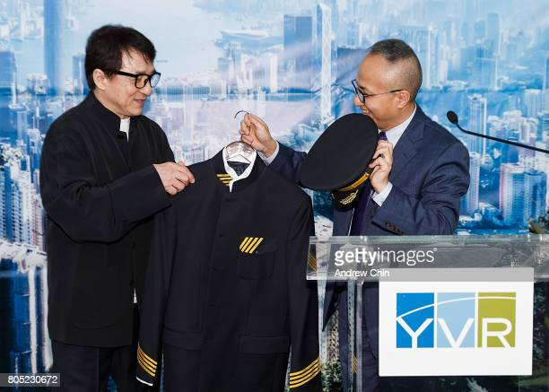 Actor and martial artist Jackie Chan receives a pilot's suit from Chief Marketing Officer of Hong Kong Airlines George Liu during the celebration of...