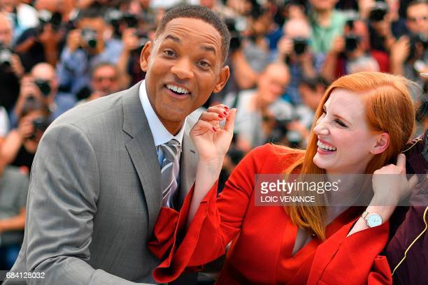 TOPSHOT US actor and member of the Feature Film jury Will Smith and US actress and member of the Feature Film jury Jessica Chastain pose on May 17...