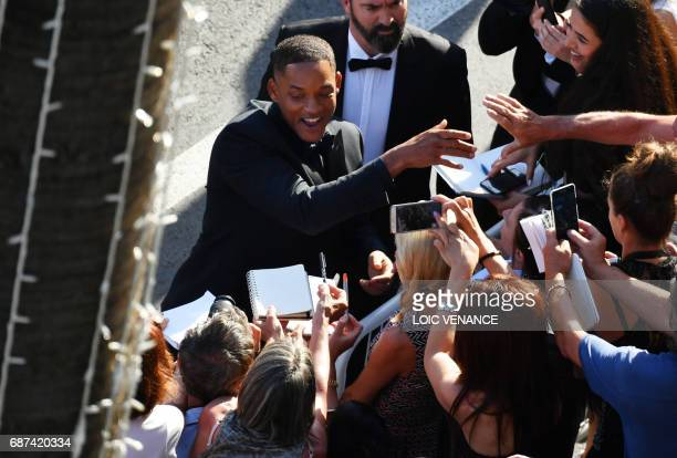 US actor and member of the Feature Film jury Will Smith greets fans as he arrives on May 23 2017 for the '70th Anniversary' ceremony of the Cannes...