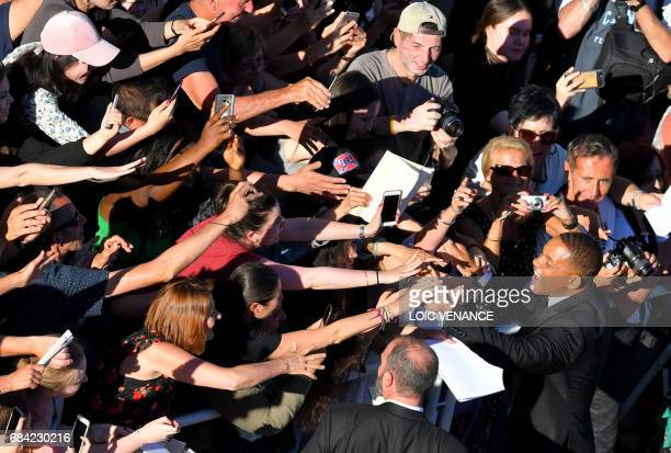 US actor and member of the Feature Film jury Will Smith poses for selfies as he arrives on May 17 2017 for the screening of the film 'Ismael's...