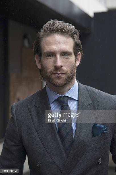 Actor and Model Craig McGinlay wears a Hackett suit shirt and tie day 2 of London Mens Fashion Week Autumn/Winter 2017 on January 07 2017 in London...