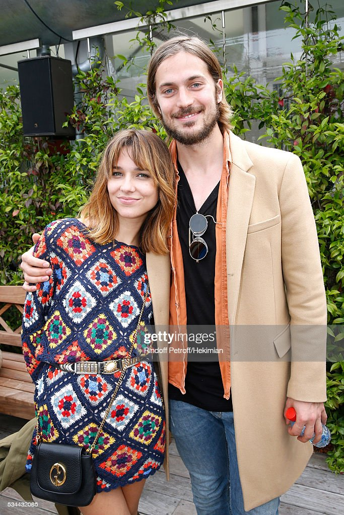 Actor and model Lucas Bravo (R) and his companion singer Louise Verneuil (L) attend the 2016 French Tennis Open - Day Five at Roland Garros