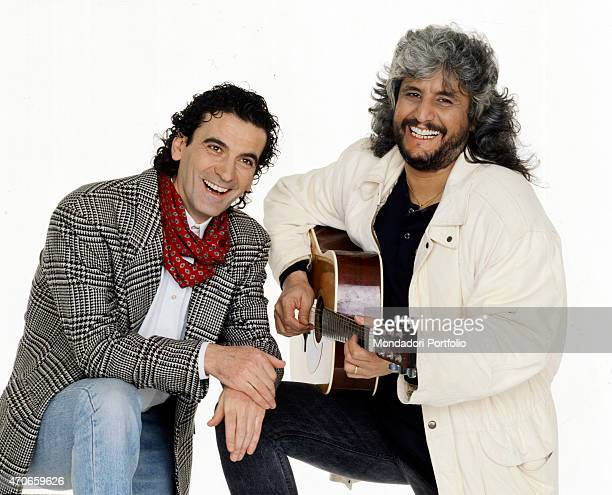 'Actor and movie director Massimo Troisi and his friend Pino Daniele a very successful musician and singer pose together smiling Daniele has worked...