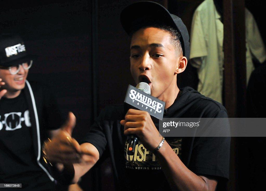 US actor and MSFTS REP brand founder Jaden Smith sings during a press conference in Taipei on May 5, 2013 as MSFTS REP and SMG for the first time launched collaboration products in Asia. Hollywood star Will Smith, who arrived in Taiwan on May 2 on a promotional tour for sci-fi flick 'After Earth', said that he will probably shoot a comedy with his son Jaden when they team up for the third time in film-making. AFP PHOTO/ Mandy CHENG