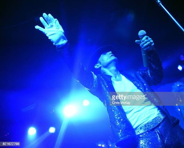 Actor and musician Corey Feldman performs his Michael Jackson tribute by singing 'Man In The Mirror' while wearing a glove and hat given to him by...