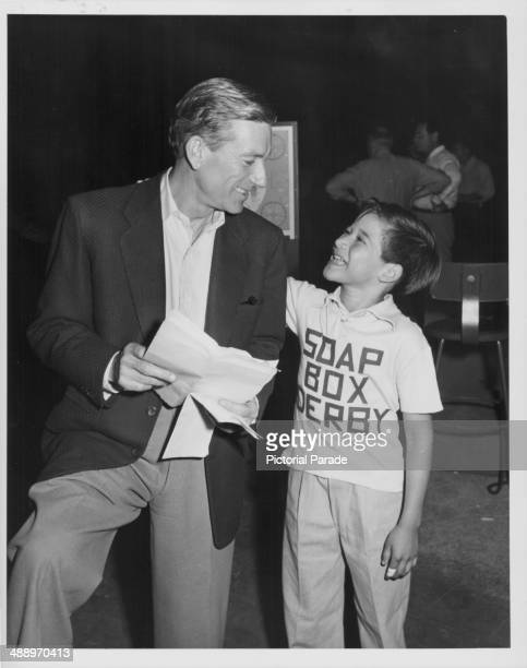 Actor and musician Hoagy Carmichael with child star Ricky Vera laughing together on the set of 'The Colgate Comedy Hour' circa 19501955