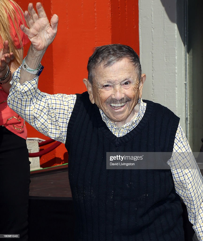 Actor and one of 'The Munchkins' from the 'Wizard of Oz' <a gi-track='captionPersonalityLinkClicked' href=/galleries/search?phrase=Jerry+Maren&family=editorial&specificpeople=3637561 ng-click='$event.stopPropagation()'>Jerry Maren</a> is immortalized with a hand and footprint ceremony at the TCL Chinese Theatre on September 18, 2013 in Hollywood, California.