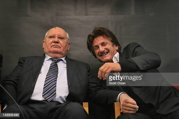 Actor and philanthropist Sean Penn chats with former Russian President Mikhail Gorbachev during a meeting with students at Frederick Von Steuben...