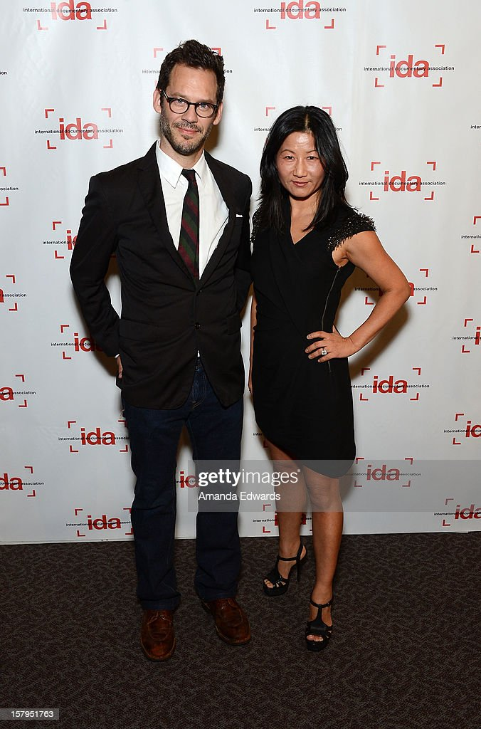 Actor and producer Chris Gartin (L) and director Unjoo Moon arrive at the International Documentary Association's 2012 IDA Documentary Awards at The Directors Guild Of America on December 7, 2012 in Los Angeles, California.