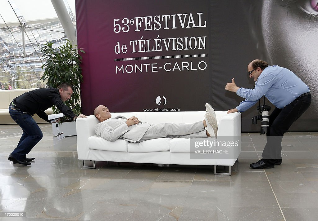 US actor and producer Corbin Bernsen lays on a sofa while posing on June 11, 2013 during a photocall at the 53rd Monte-Carlo Television Festival in Monaco. The Monte-Carlo Television Festival held since 1961, aims at encouraging the new art form of television. AFP PHOTO / VALERY HACHE