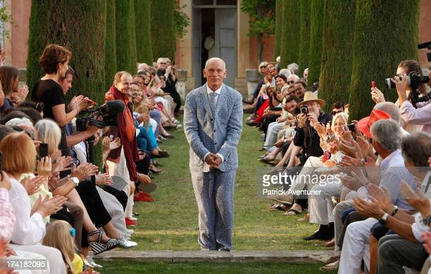 Actor and producer John Malkovich shows his SpringSummer 2013 'Technobohemian' collection at the Chateau de l'Ange in the Luberon on July 20 2013 in...
