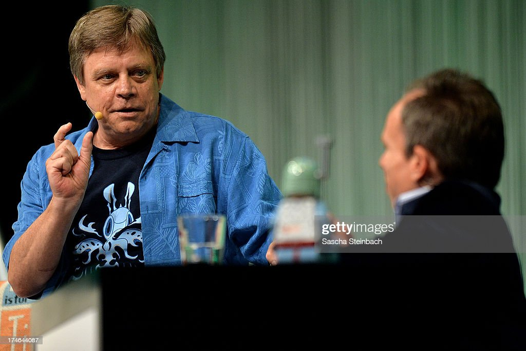 Actor and producer Mark Hamill (L), best known for his performance as Luke Skywalker in the original Star Wars trilogy, and actor Warwick Davis (R) attend the Star Wars Celebration at Messe Essen on July 28, 2013 in Essen, Germany.