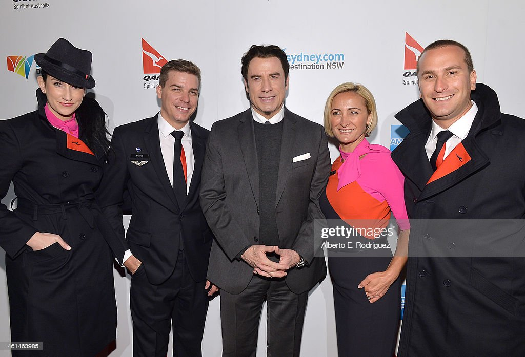 Actor and Qantas Ambassador <a gi-track='captionPersonalityLinkClicked' href=/galleries/search?phrase=John+Travolta&family=editorial&specificpeople=178204 ng-click='$event.stopPropagation()'>John Travolta</a> (C) and Qantas Cabin Crew attend the Qantas Spirit Of Australia Party on January 8, 2014 in Beverly Hills, California.