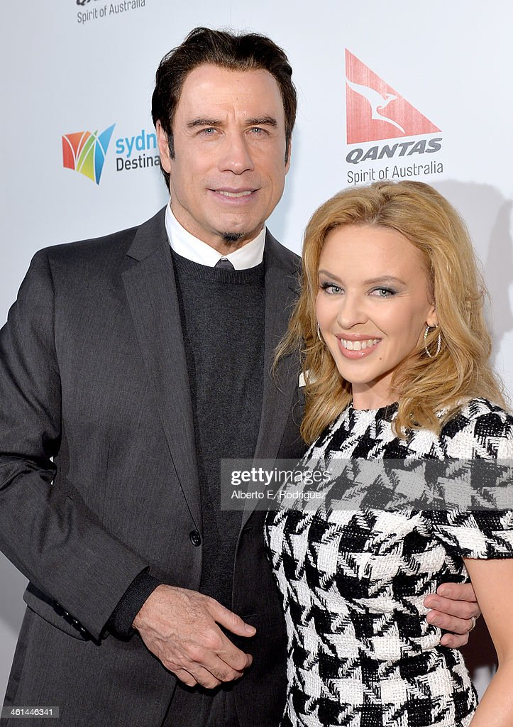 Actor and Qantas Ambassador <a gi-track='captionPersonalityLinkClicked' href=/galleries/search?phrase=John+Travolta&family=editorial&specificpeople=178204 ng-click='$event.stopPropagation()'>John Travolta</a> (L) and singer <a gi-track='captionPersonalityLinkClicked' href=/galleries/search?phrase=Kylie+Minogue&family=editorial&specificpeople=201671 ng-click='$event.stopPropagation()'>Kylie Minogue</a> attend the Qantas Spirit of Australia Party on January 8, 2014 in Beverly Hills, California.