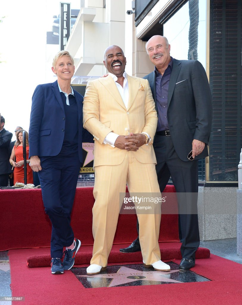 Actor and radio host <a gi-track='captionPersonalityLinkClicked' href=/galleries/search?phrase=Steve+Harvey&family=editorial&specificpeople=210865 ng-click='$event.stopPropagation()'>Steve Harvey</a> (C) poses on his star on the Hollywood Walk of Fame with television personalities <a gi-track='captionPersonalityLinkClicked' href=/galleries/search?phrase=Ellen+DeGeneres&family=editorial&specificpeople=171367 ng-click='$event.stopPropagation()'>Ellen DeGeneres</a> (L) and Dr <a gi-track='captionPersonalityLinkClicked' href=/galleries/search?phrase=Phil+McGraw&family=editorial&specificpeople=234933 ng-click='$event.stopPropagation()'>Phil McGraw</a> (R) at the unveiling ceremony for the star on May 13, 2013 in Hollywood, California.