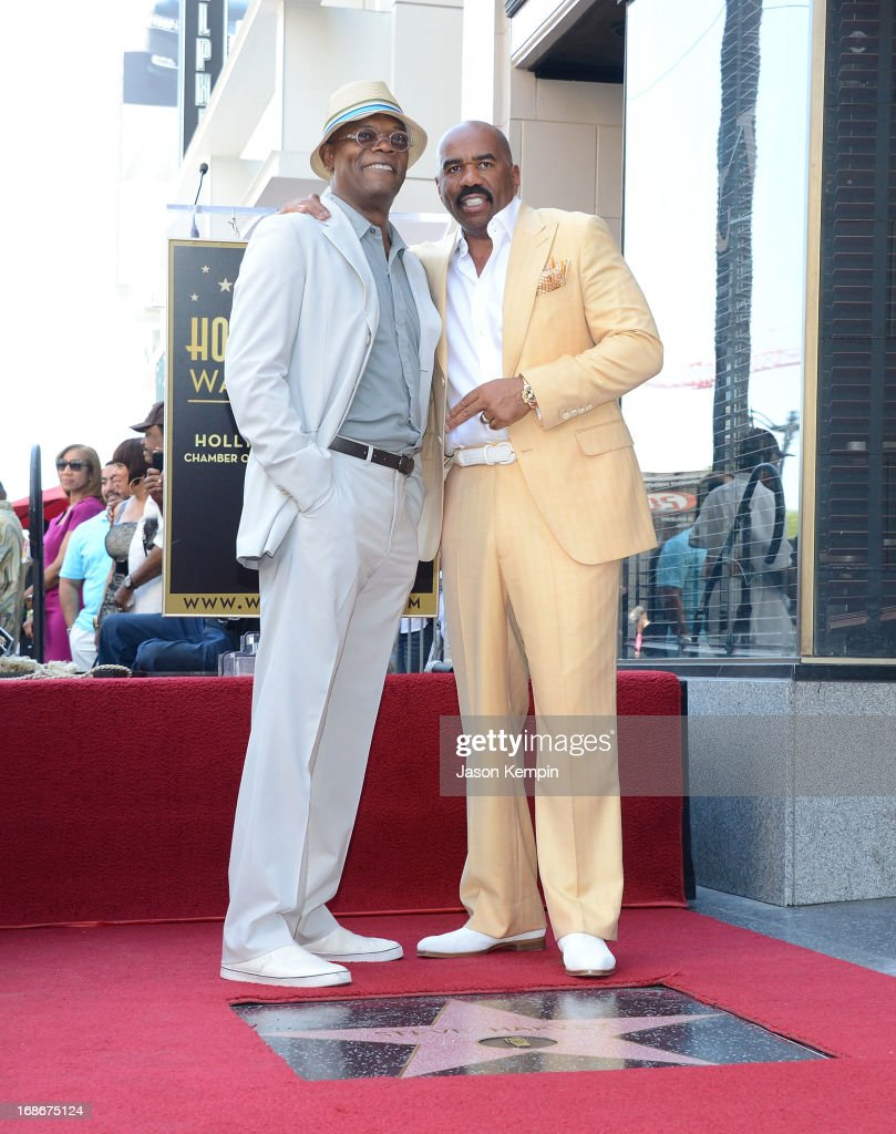 Actor and radio host <a gi-track='captionPersonalityLinkClicked' href=/galleries/search?phrase=Steve+Harvey&family=editorial&specificpeople=210865 ng-click='$event.stopPropagation()'>Steve Harvey</a> (R) poses on his star on the Hollywood Walk of Fame with actor Samuel L Jackson at the unveiling ceremony for the star on May 13, 2013 in Hollywood, California.
