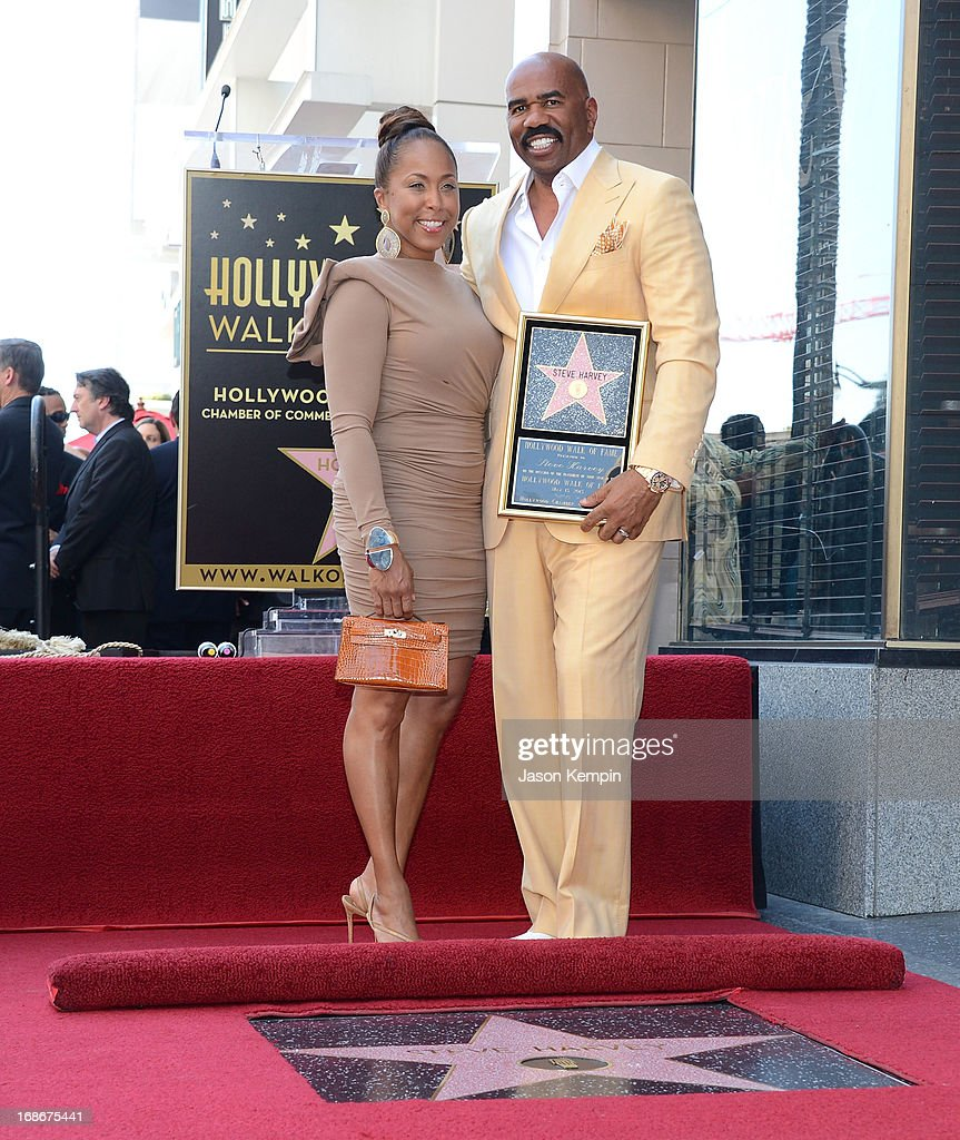 Actor and radio host <a gi-track='captionPersonalityLinkClicked' href=/galleries/search?phrase=Steve+Harvey&family=editorial&specificpeople=210865 ng-click='$event.stopPropagation()'>Steve Harvey</a> (R) poses on his star on the Hollywood Walk of Fame with his wife Marjorie Bridges Townsend Woods Harvey at the unveiling ceremony for the star on May 13, 2013 in Hollywood, California.