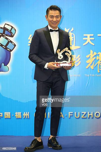 Actor and singer Andy Lau wins the Best Actor during the 2nd Silk Road International Film Festival at Haixia Olympic Center Stadium on September 26...