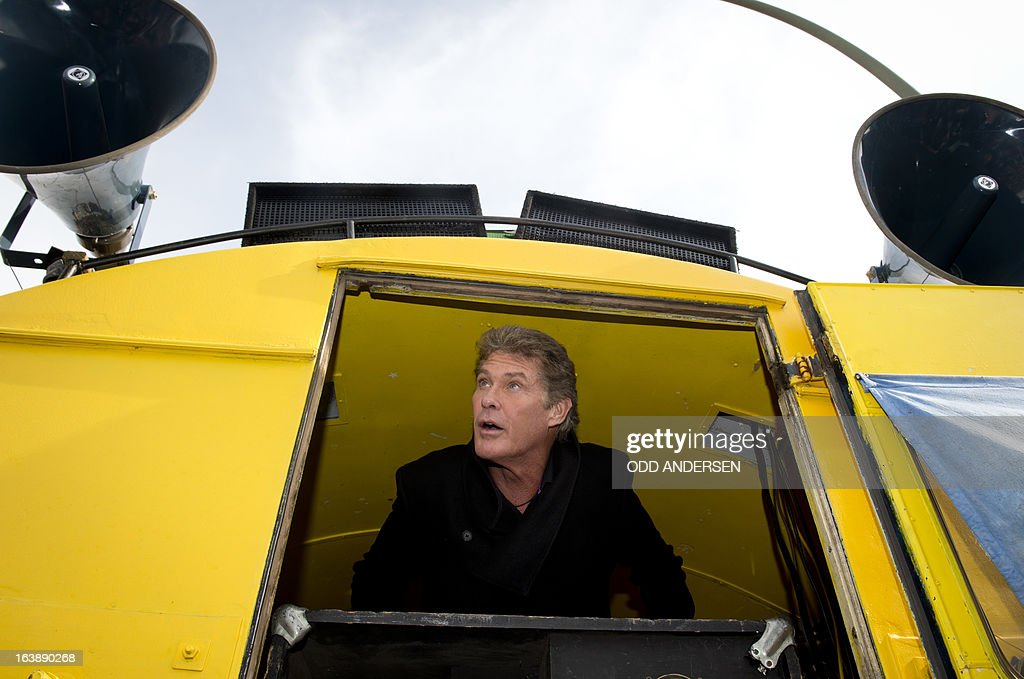 US actor and singer David Hasselhoff looks out at the crowd before addressing fans and campaigners at the East Side Gallery on March 17, 2013 in Berlin, Germany, to protest against the planned demolition of a part of these remains of the former Berlin Wall.Thousands of people gathered as the former Bay Watch star came to the German capital to lend his support to the movement that wants to preserve the 1,3km long stretch of the cold war symbol and keep the land along the river Spree as public land.
