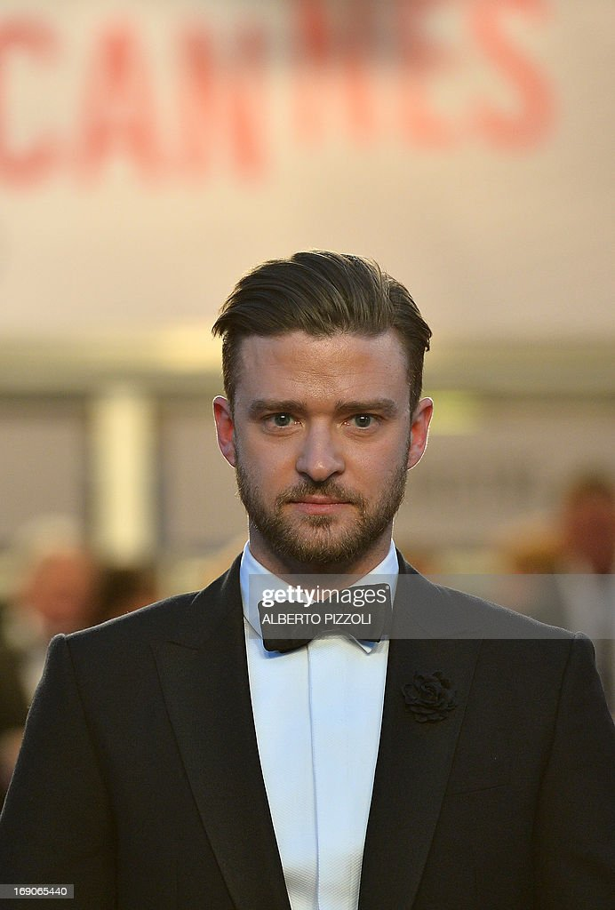 US actor and singer Justin Timberlake poses on May 19, 2013 as he leaves following the screening of the film 'Inside Llewyn Davis' presented in Competition at the 66th edition of the Cannes Film Festival in Cannes. Cannes, one of the world's top film festivals, opened on May 15 and will climax on May 26 with awards selected by a jury headed this year by Hollywood legend Steven Spielberg.