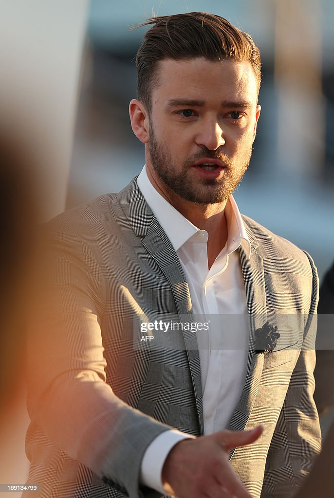 US actor and singer Justin Timberlake smiles on May 20, 2013 as he takes part in the show 'Le Grand Journal' on the set of the French TV Canal+, on the sidelines the 66th Cannes film festival in Cannes. Cannes, one of the world's top film festivals, opened on May 15 and will climax on May 26 with awards selected by a jury headed this year by Hollywood legend Steven Spielberg.