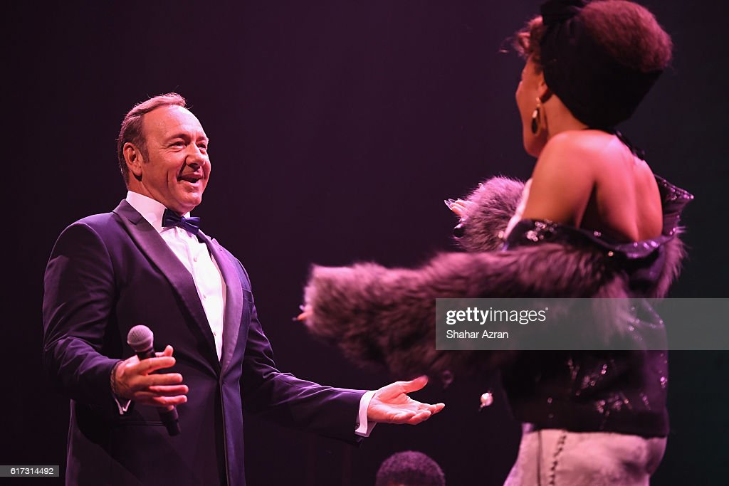 Actor and singer Kevin Spacey and singer Andra Day perform during the '100: The Apollo Celebrates Ella' at the Apollo Theater on October 22, 2016 in New York City.
