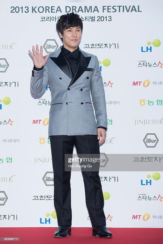 Actor and singer Kim DongWan of South Korean boy band Shinhwa arrives for photographs at 2013 Korea Drama Awards at Jinju Arena on October 02 2013 in...